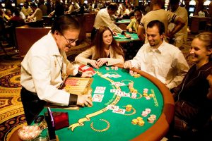 Blackjack table in las Vegas, Nevada, Caesars Palace and Casino, gaming, gambling, chips, blackjack, betting croupier, blackjack players, model released, blackjack table, cards, NV, Las Vegas, Photo nv245-17155. Copyright: Lee Foster, www.fostertravel.com, 510-549-2202,lee@fostertravel.com